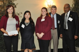 CTCPA Educational Trust Fund Trustee Katherine McNair, CPA (left) presents grants to the University of Connecticut Accounting Department, Accounting Society, and Beta Alpha Psi chapter.  Accepting the awards are University of Connecticut representatives (from left) students Grace Kim, Sarah Levis, Instructor-In-Residence and Assistant Department Head for Undergraduate Programs David Papandria, and Professor and Accounting Department Head Dr. Mohammed Hussein.